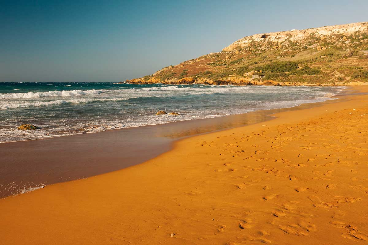 A red sand beach on Gozo